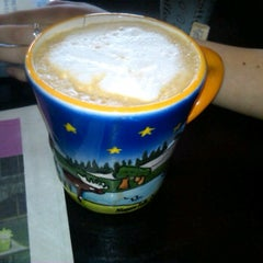 Photo taken at Rodrigue's Coffee House by Amanda V. on 4/12/2012