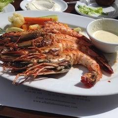 Photo taken at Al Hallab Restaurant by Aisha A. on 6/15/2012