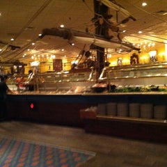 Photo taken at Captain George's Seafood Buffet by Emily W. on 8/30/2012