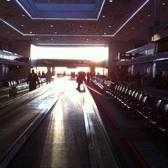Photo taken at Gate B60 by Timothy B. on 3/13/2012
