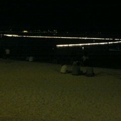 Photo taken at Memorial Day Lantern Floating Ceremony @ Ala Moana Beach Park by Devin S. on 5/29/2012