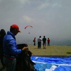 Photo taken at Puncak Paralayang by Aliie L. Fernandez on 7/29/2012
