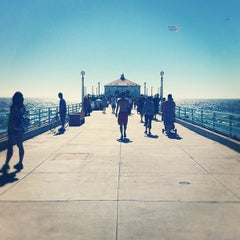 Photo taken at Manhattan Beach Pier by Jocelyn L. on 9/2/2012