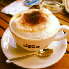 Photo taken at Caffé Nero by Simge on 8/31/2012