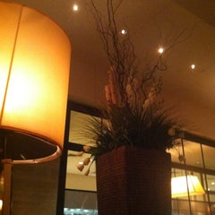 Photo taken at Wolfgang Puck Grille by Alejandro G. on 4/26/2012