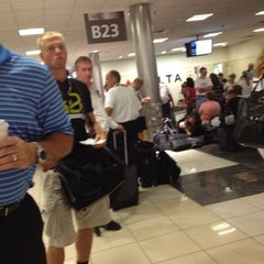 Photo taken at Concourse B by Topher on 7/27/2012
