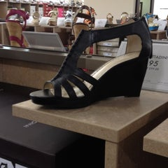 Photo taken at DSW Designer Shoe Warehouse by Amy V. on 5/10/2012