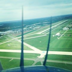 Photo taken at Wittman Regional Airport (OSH) by Rose D. on 5/21/2012