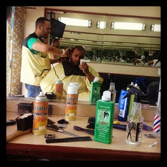Photo taken at Dominguez Barbershop by Hector A. on 6/28/2012