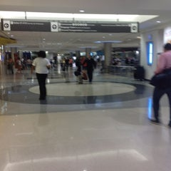 Photo taken at Concourse E by Jose V. on 8/1/2012