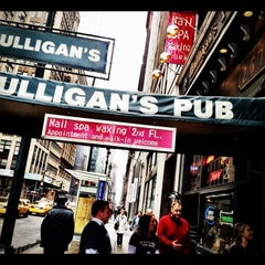 Photo taken at Mulligan's Pub by Dana M. on 3/31/2012