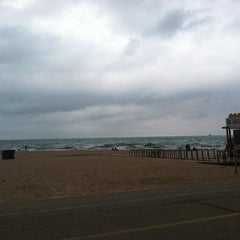 Photo taken at Oak Street Beach by nikki s. on 7/20/2012