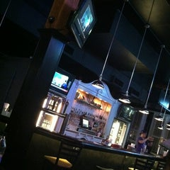 Photo taken at Industry Bar & Kitchen by Blake H. on 2/24/2012