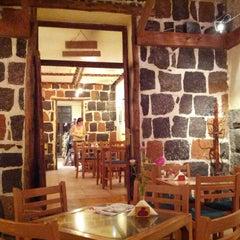 Photo taken at Artbridge Bookstore Café by Mite K. on 9/13/2012