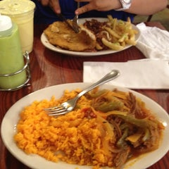 Photo taken at Sophie's Cuban Cuisine by Adam B. on 6/8/2012