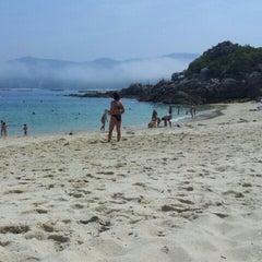 Photo taken at Praia de Castiñeiras by Fabian G. on 7/25/2012