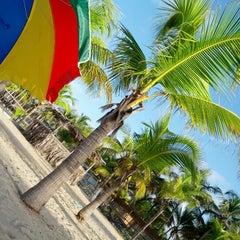 Photo taken at Playa de Boca de Uchire by Zoris V. on 8/20/2012