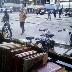 Photo taken at The American Book Center by Julia D. on 3/9/2012