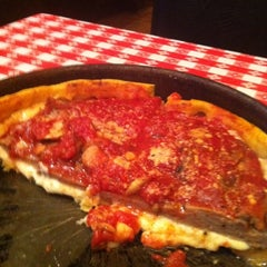 Photo taken at Gino's East by Steve S. on 4/6/2012