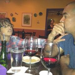 Photo taken at Purple Olive International Bistro by Inna H. on 5/12/2012