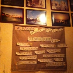 Photo taken at Arguila cafe by Junko on 3/6/2012