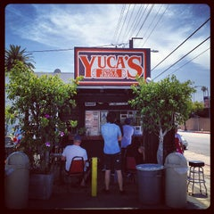 Photo taken at Yuca's Taqueria by Bennett K. on 4/18/2012
