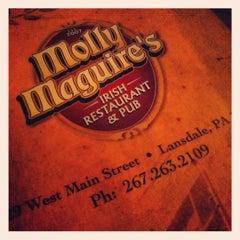Photo taken at Molly Maguire's Irish Restaurant & Pub by Ian W. on 8/2/2012
