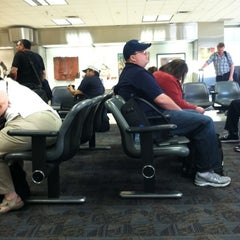 Photo taken at Gate T12 by Mike P. on 4/3/2012