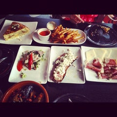 Photo taken at Estragon Tapas Bar by Lilly L. on 5/12/2012