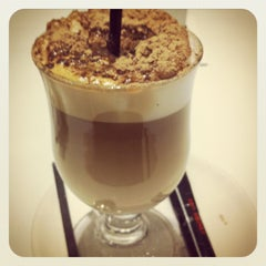Photo taken at Café Tortoni by Elena A. on 2/17/2012