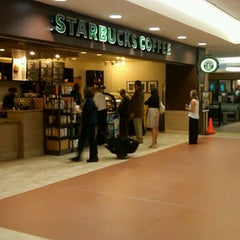 Photo taken at Starbucks by Enio P. on 4/16/2012