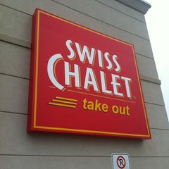 Photo taken at Swiss Chalet by Veronica N. on 6/17/2012
