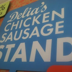 Photo taken at Delia's Chicken Sausage Stand by Shani E. on 6/23/2012