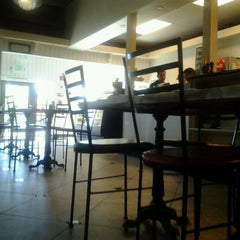 Photo taken at Bell Tower Bistro & Patisserie by Bridget D. on 5/24/2012