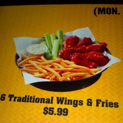 Photo taken at Buffalo Wild Wings by Kirbe F. on 7/20/2012