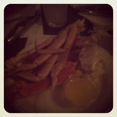 Photo taken at The Boston Hotel's Steak & Crabhouse by Ashley R. on 8/28/2012