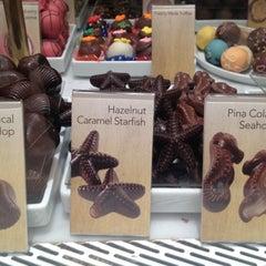 Photo taken at Godiva Chocolatier by Rachel F. on 8/11/2012