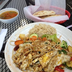 Photo taken at Umami Mongolian Grill by Alex N. on 6/7/2012