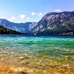 Photo taken at Bohinjsko jezero (Bohinj Lake) by Nina ⚓. on 8/25/2012