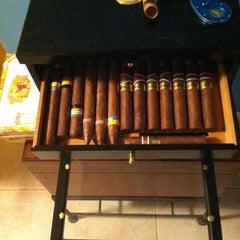 Photo taken at LIT Premium Cigar Lounge by Dennis P. on 3/25/2012