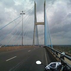 Photo taken at Cầu Mỹ Thuận by Quang B. on 6/15/2012