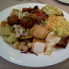 Photo taken at Lótus Restaurante Vegetariano by Caio A. on 2/8/2012