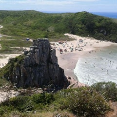 Photo taken at Praia da Guarita by Assis H. on 2/23/2012