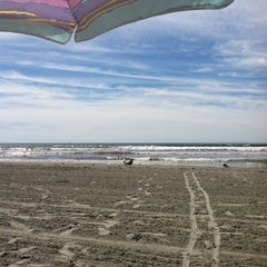 Photo taken at First Beach by Dana V. on 8/7/2012