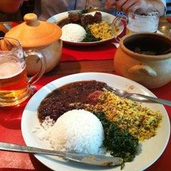 Photo taken at John John Cafe by Manoel S. on 5/4/2012