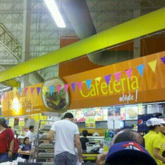 Photo taken at Éxito by CamiLo V. on 6/23/2012