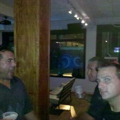 Photo taken at Aqua Restaurant & Bar by Christopher F. on 8/4/2012