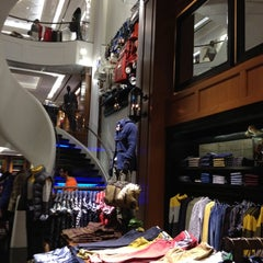 Photo taken at Tommy Hilfiger by Jeannett A. on 8/26/2012