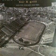 Photo taken at Westside Stadium Bar & Grill by Kimberlee M. on 5/10/2012