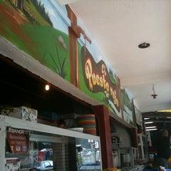 Photo taken at El Puesto Rojo by Eddie H. on 8/4/2012